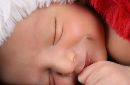 Newborn baby boy wearing a christmas hat