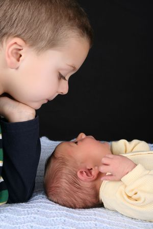 Blond boy with his newborn baby brother