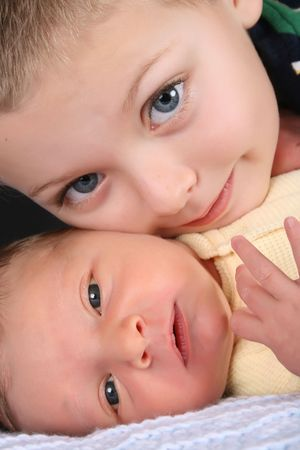 Blond boy with his newborn baby brother Stock Photo - 7941640