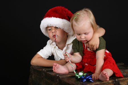 Christmas brother and sister eating Candy Canes  photo