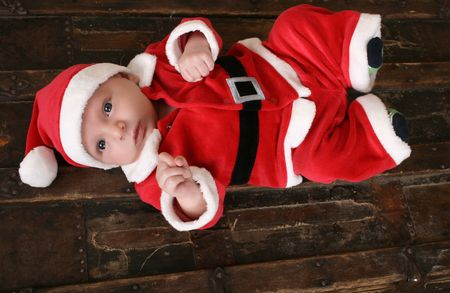 Cute 6 week old baby boy in christmas suit photo