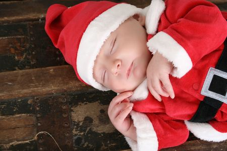 Cute six week old baby santa sleeping photo