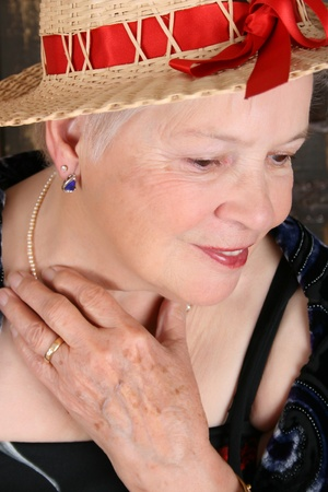 Beautiful female wearing a straw hat with red ribbon photo