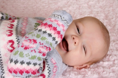 chuckle: Cute two month old smiling baby girl