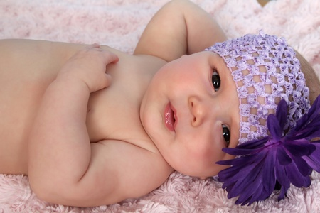 cute baby girl: Cute baby girl lying on her back relaxing