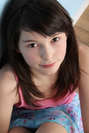 Beautiful brunette teen displaying innocent expression Stock Photo - 8914846