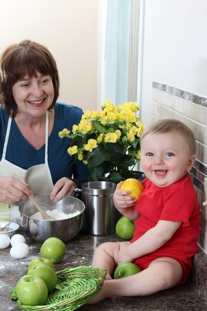 Grandmother and grandson in the kitchen baking cake Stock Photo - 9495875