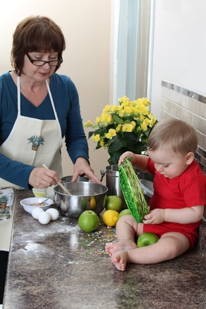 Grandmother and grandson in the kitchen baking cake Stock Photo - 9495882