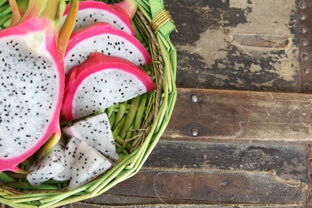 Pink pitahaya dragon fruit background sliced in pieces Stock Photo - 9698265
