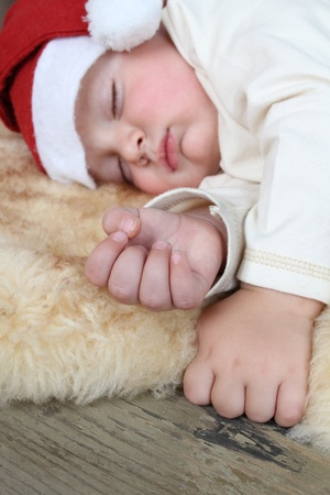 Baby wearing a christmas hat sleeping sound photo