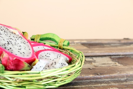 Pink pitahaya dragon fruit basket sliced in pieces  Stock Photo - 10181440