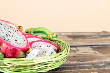 Pink pitahaya dragon fruit basket sliced in pieces Stock Photo - 10181440