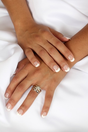 Native brides hands on her white wedding gown Stock Photo - 10270902