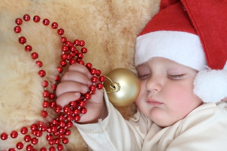 Baby boy wearing a christmas hat sleeping sound photo