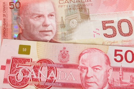 Old and new Canadian fifty dollar notes photo