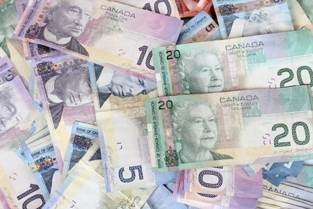 canadian cash: Background of Canadian currency dollar bills in pile Stock Photo