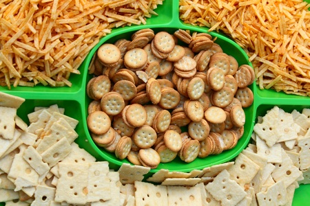 Variety of salty snacks on a green plate photo