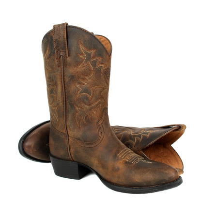 old cowboy: Pair of brown leather cowboy boots on white background