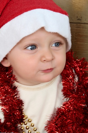 Cute baby boy wearing a christmas hat photo
