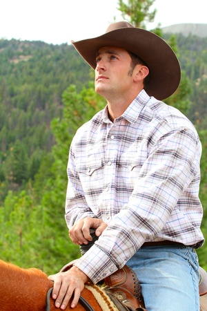 cowboy man: Passionate young cowboy spending time with his horse Stock Photo