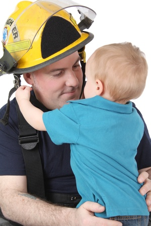 Toddler son of a fireman looking at him  Archivio Fotografico