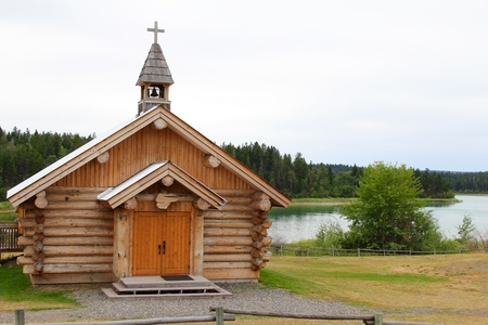Log chapel on waterfront in British Columbia Canada photo