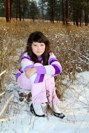 native american girl: Young brunette teen in the field after the snowfall
