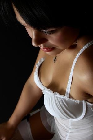 native american woman: Beautiful brunette female in lingerie against black