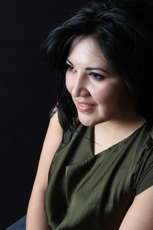 Stylish Native American woman against a dark background photo