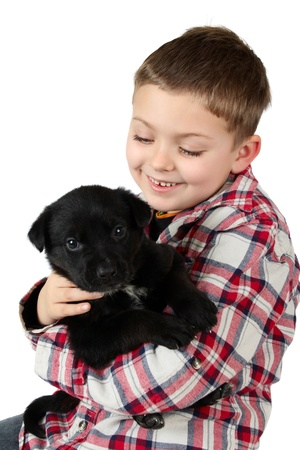 red heeler: Beautiful blond boy with a black puppy Stock Photo