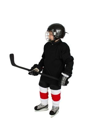 Young boy in ice hockey gear against white photo