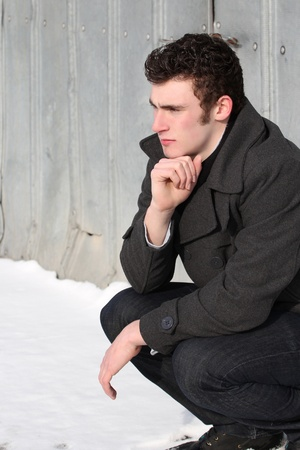 Attractive brunette male outside on a cold winters day photo
