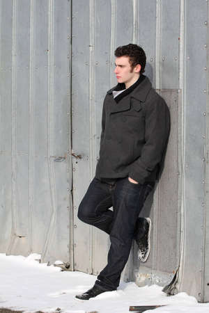 winters: Attractive brunette male outside on a cold winters day