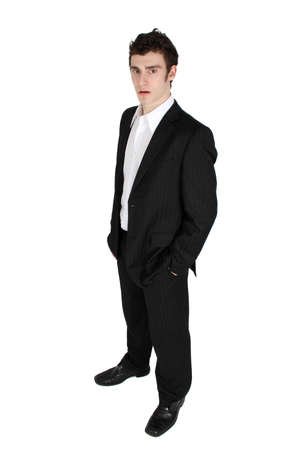 Attractive brunette male in suit with white shirt  Stock Photo - 12669874