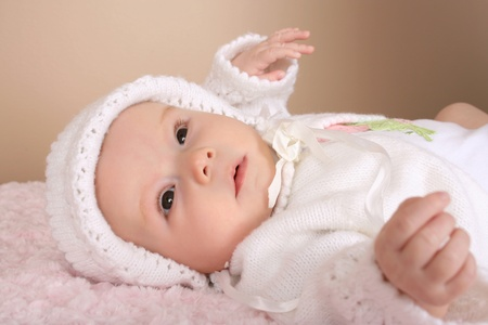Cute baby girl wearing a knitted bonnet en jersey photo