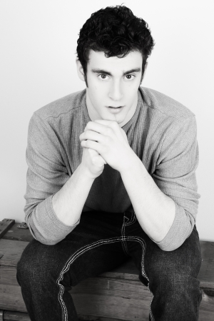 handome: Attractive brunette male model in casual grey shirt