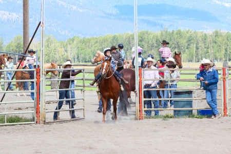 MERRITT, B.C. CANADA - JUNE 2: Unidentified Cowboy entering the arena for the Stake Race event at the Little Britches Rodeo June 2, 2012 in Merritt British Columbia, Canada