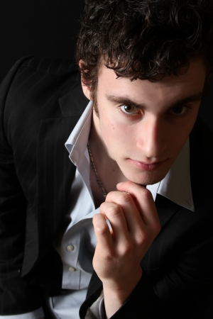 Attractive brunette male model in black dress shirt photo