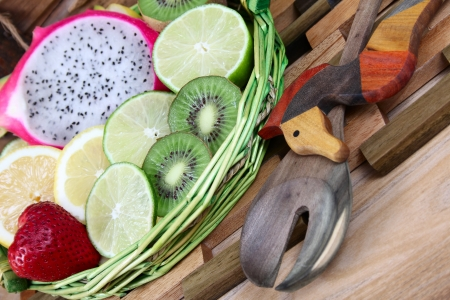 utencils: Fruit basket with utencils and variety of fruits Stock Photo