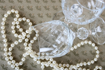 String of pearls and crystal wine glasses