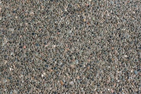 Gravel road texture with various colored stones photo