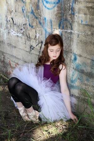 Beautiful girl wearing a white tutu against graffiti wall photo