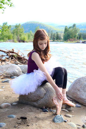 Beautiful girl wearing a white tutu by the river Stock Photo