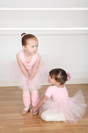 ballet bar: Beautiful little ballet dancers at the dance studio barre