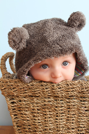 four month: Four month old baby boy wearing a fully bear suit