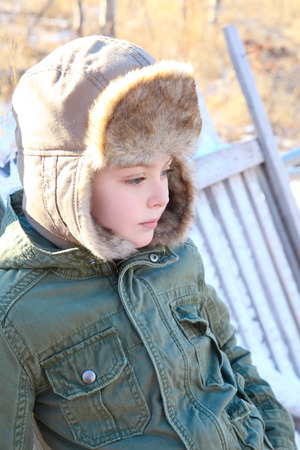 Young boy outside on a cold winters day photo