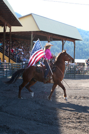 rancher: MERRITT B.C. CANADA  May 30 2015: Opening ceremony horse rider at The 3nd Annual Ty Pozzobon Invitational PBR Event. Editorial