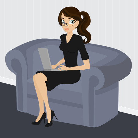 sit stay: A young gorgeous woman works on her laptop while sitting on a couch
