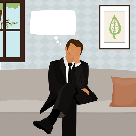 anguished: Man sitting on a couch with a worried expression