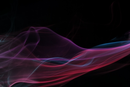 Multi-colored smoke on black background photo